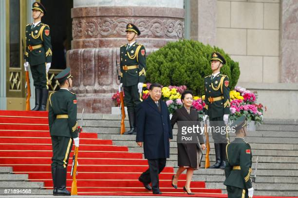 China's President Xi Jinping and First Lady Peng Liyuan arrive for US President Donald Trump's welcoming ceremony on November 9 2017 in Beijing China...