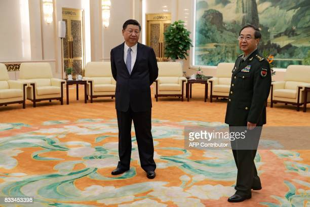 China's President Xi Jinping and General Fang Fenghui chief of the general staff of the Chinese People's Liberation Army wait to meet General Joseph...