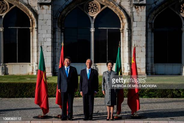 China's President Xi Jinping and his wife China's First Lady Peng Liyuan are welcomed by Portugal's President Marcelo Rebelo de Sousa upon their...