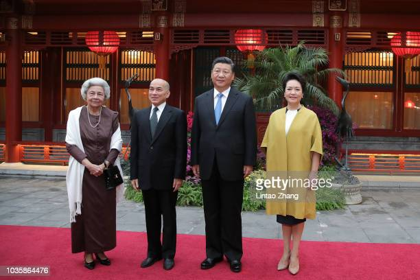 China's President Xi Jinping and his wife Peng Liyuan welcome Cambodia's King Norodom Sihamoni and his mother former Queen Monique at Diaoyutai State...