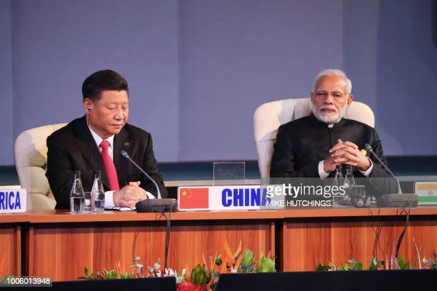 China's President Xi Jinping and India's Prime Minister Narendra Modi attend a session meeting during the 10th BRICS summit on July 27 2018 in...