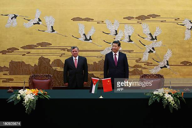 China's President Xi Jinping and Jordan's King Abdullah II attend a signing ceremony at the Great Hall of People in Beijing on September 18, 2013....