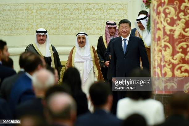 China's President Xi Jinping and Kuwaiti ruling Emir Sheikh Sabah alAhmad alJaber alSabah arrive for the 8th Ministerial Meeting of ChinaArab States...