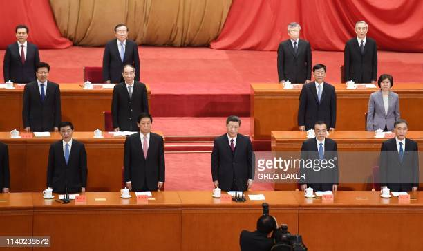 China's President Xi Jinping and other leaders sing the national anthem at a ceremony marking the centennial of the May Fourth Movement a landmark...