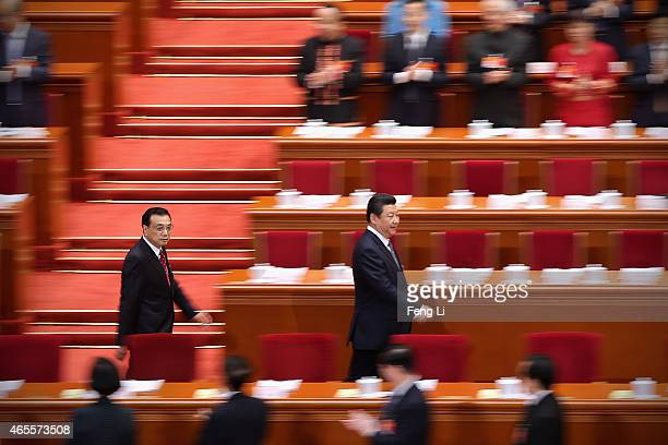 China's President Xi Jinping and Premier Li Keqiang arrive for the second plenary session of China's parliament the National People's Congress at the...