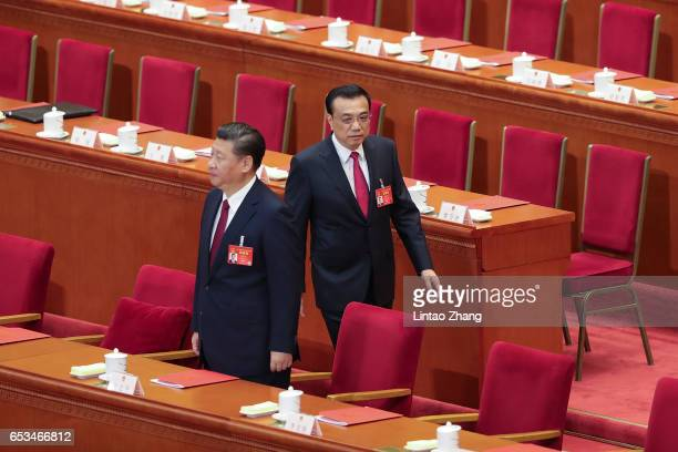 China's President Xi Jinping and Premier Li Keqiang attends closing meeting of the Fifth Session of the 12th National People's Congress at the Great...