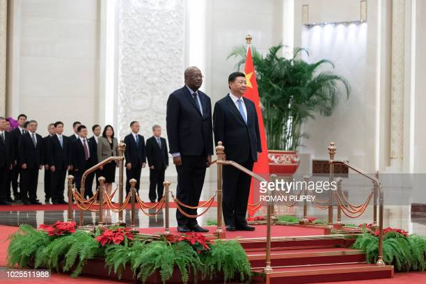 China's President Xi Jinping and President of Burkina Faso Roch Marc Christian Kabore attend the welcome ceremony at the Great Hall of the People in...
