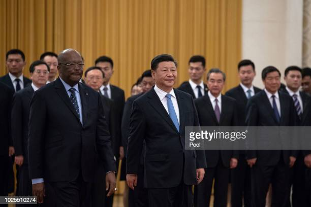 China's President Xi Jinping and President of Burkina Faso Roch Mark Christian Kabore arrive for the welcome ceremony at the Great Hall of the People...