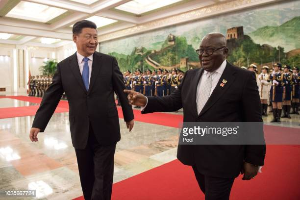 China's President Xi Jinping and President of Ghana Nana AkufoAddo review the Chinese People's Liberation Army honour guard during the welcome...