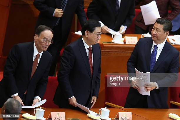 China's President Xi Jinping and Secretary of the Central Commission for Discipline Inspection Wang Qishan leave the opening session of the Chinese...