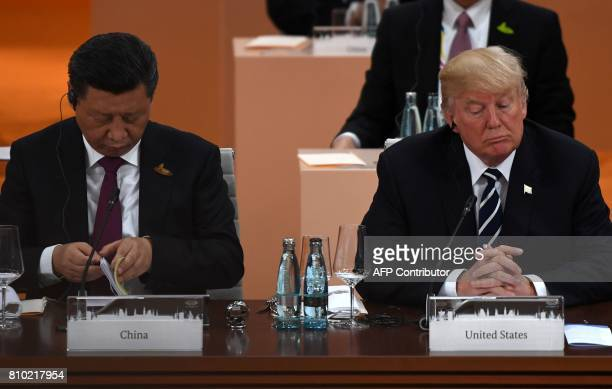 China's President Xi Jinping and US President Donald Trump attend a working session on the first day of the G20 summit in Hamburg northern Germany on...