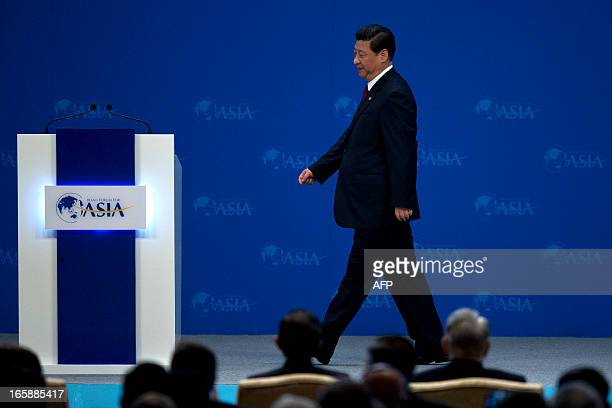 China's President Xi Jinping arrives at the opening ceremony of the annual the Boao Forum for Asia in Boao, in southern China's Hainan province, on...