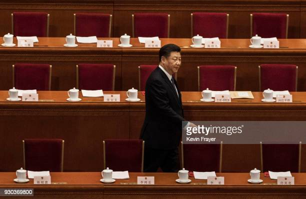 China's President Xi Jinping arrives to a session of the National People's Congress to vote on a constitutional amendment at The Great Hall of The...