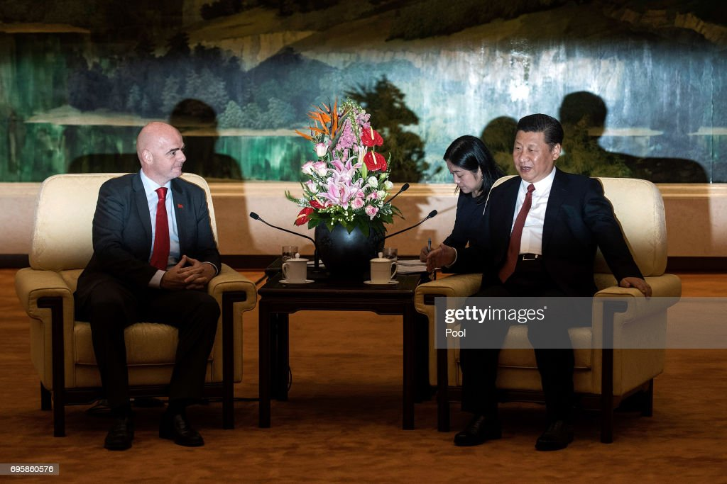 China's President Xi Jinping attends a meeting with FIFA President Gianni Infantino at the Great Hall of the People in Beijing on June 14, 2017 in Beijing,