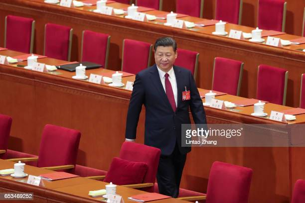 China's President Xi Jinping attends closing meeting of the Fifth Session of the 12th National People's Congress at the Great Hall of the People on...