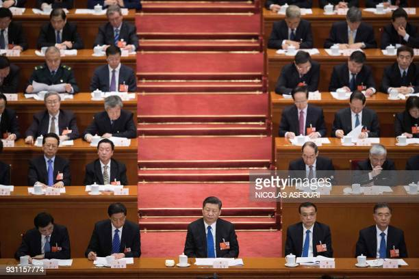 China's President Xi Jinping attends the fourth plenary session of the National People's Congress at the Great Hall of the People in Beijing on March...