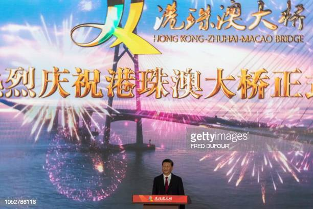China's President Xi Jinping attends the opening ceremony of the Hong KongZhuhaiMacau Bridge at the Zhuhai Port terminal on October 23 2018 China's...