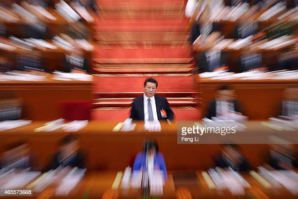 China's President Xi Jinping attends the second plenary session of China's parliament the National People's Congress at the Great Hall of the People...