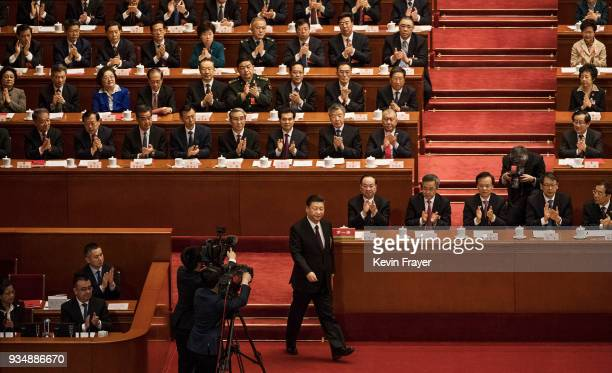 China's President Xi Jinping bottom center walks to the podium to make a speech to the closing session of the National People's Congress at The Great...