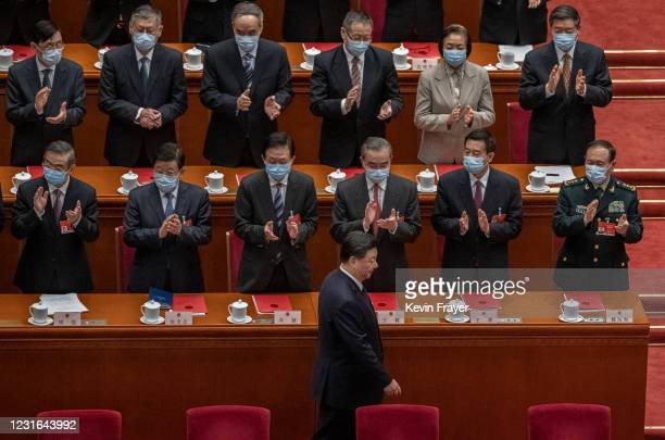 China's President Xi Jinping, bottom, is applauded by lawmakers as he arrives for the closing session of the National People's Congress at the Great...