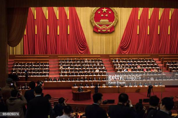 China's President Xi Jinping bottom speaks to the closing session of the National People's Congress at The Great Hall Of The People on March 20 2018...