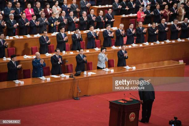 China's President Xi Jinping bows after swearing under oath after being elected for a second term during the fifth plenary session of the first...