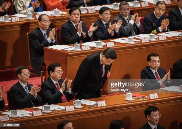 China's President Xi Jinping center bows after his speech to the closing session of the National People's Congress at The Great Hall Of The People on...