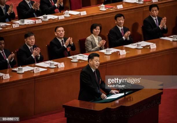 China's President Xi Jinping center speaks to the closing session of the National People's Congress at The Great Hall Of The People on March 20 2018...