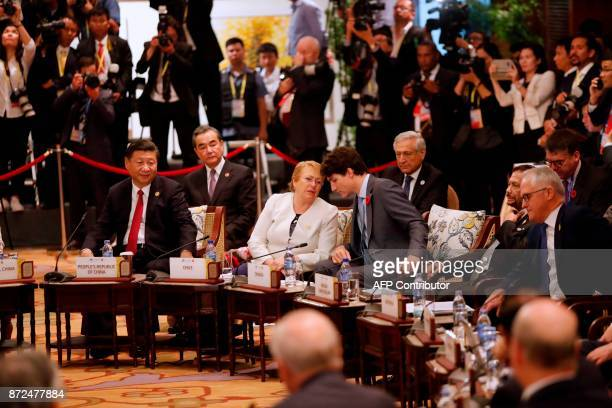 China's President Xi Jinping Chile's President Michelle Bachelet Canada's Prime Minister Justin Trudeau Brunei's Sultan Hassanal Bolkiah and...