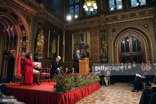 China's President Xi Jinping delivers a speech as British Prime Minister David Cameron speaker of the House of Lords Baroness D'Souza speaker of the...
