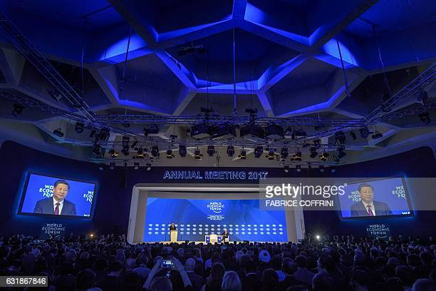 China's President Xi Jinping delivers a speech during the first day of the World Economic Forum on January 17 2017 in Davos Chinese President Xi...