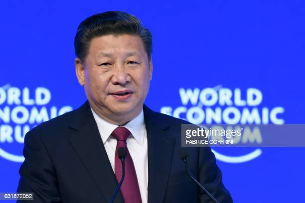 China's President Xi Jinping delivers a speech on the opening day of the World Economic Forum on January 17 2017 in Davos The global elite begin a...
