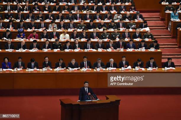 China's President Xi Jinping gives a speech at the opening session of the Chinese Communist Party's five-yearly Congress at the Great Hall of the...