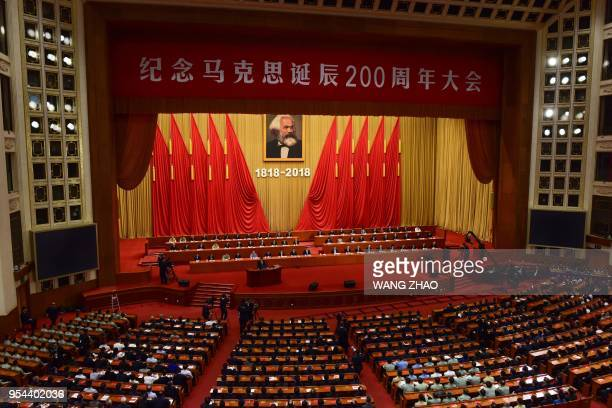 China's President Xi Jinping gives a speech during a ceremony to mark the 200th birth anniversary of German philosopher Karl Marx at the Great Hall...