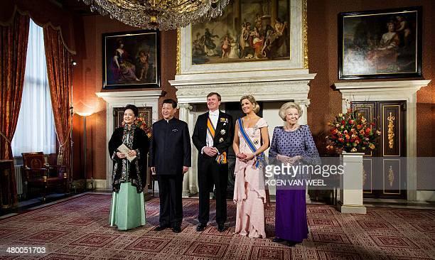 China's President Xi Jinping , his wife Peng Liyuan , Dutch King Willem Alexander , Queen Maxima and Princess Beatrix pose for a photo at the Royal...