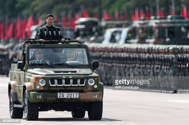 China's President Xi Jinping inspects People's Liberation Army soldiers at a barracks in Hong Kong on June 30 2017 Xi tours a garrison of Hong Kong's...