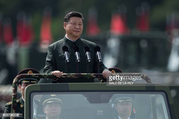 China's President Xi Jinping inspects People's Liberation Army soldiers at a barracks in Hong Kong on June 30 2017 Tanks missile launchers and...