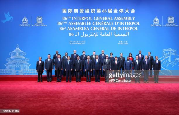 China's President Xi Jinping Interpol Secretary General Jurgen Stock and Meng Hongwei president of Interpol pose for a group photo with various...