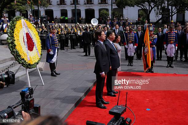China's President Xi Jinping is accompanied by Ecuador's Foreign Minister Guillaume Long during the wreath laying ceremony at the Monument to the...