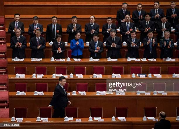 China's President Xi Jinping is applauded as he arrives to a session of the National People's Congress to vote on a constitutional amendment at The...