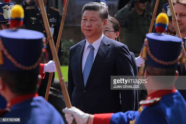 China's President Xi Jinping is pictured during the wreath laying ceremony at the Monument to the Independence Heroes in Quito during his official...