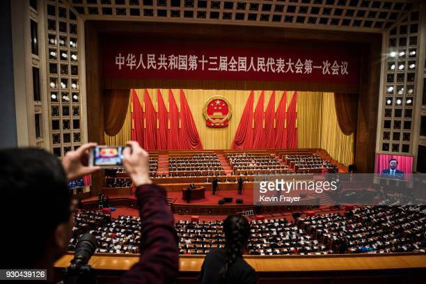 China's President Xi Jinping joins a session of the National People's Congress to vote on a constitutional amendment at The Great Hall Of The People...