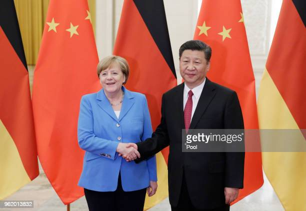 China's President Xi Jinping meets German Chancellor Angela Merkel at the Great Hall of the People in Beijing, China, May 24, 2018.