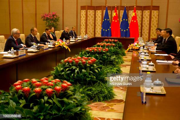 China's President Xi Jinping meets with European Commission President JeanClaude Juncker and European Council President Donald Tusk during a meeting...