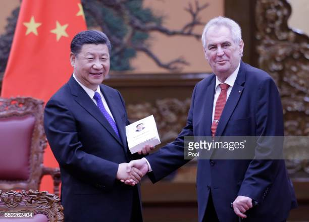 China's President Xi Jinping presents his book as a gift to Czech President Milos Zeman after a meeting at the Great Hall of the People in Beijing...