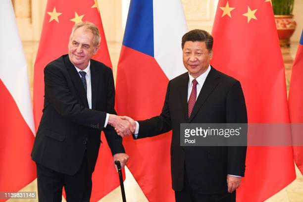 China's President Xi Jinping, right, shakes hands with Czech Republic's President Milos Zeman before their meeting at the Great Hall of the People on...