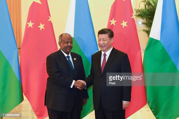 China's President Xi Jinping right shakes hands with Djibouti's President Ismail Omar Guelleh before a meeting at the Great Hall of the People on...