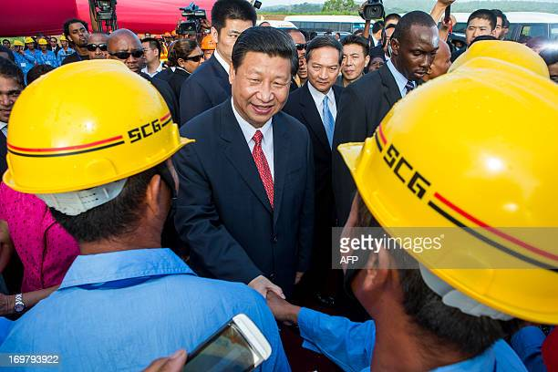China's President Xi Jinping shake hands with Chinese construction workers at the site of the Couva Children´s Hospital in Port-of-Spain, Trinidad...