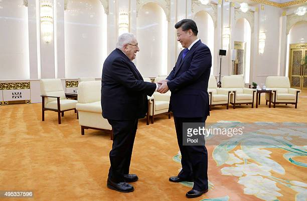 China's President Xi Jinping shakes hands with former US Secretary of State Henry Kissinger who is leading the ChinaUS Track Two Dialogue during a...