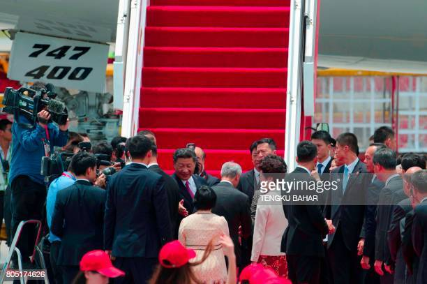China's President Xi Jinping shakes hands with Hong Kong officials as he prepares to depart from Hong Kong's international airport on July 1 2017 Xi...